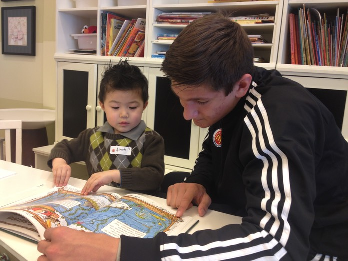 Grayson Allen (Duke) Reading to child at Ronald McDonald House
